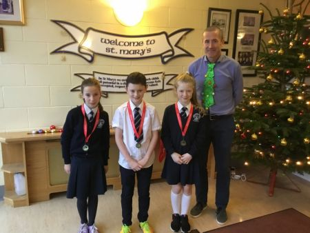 Well done to Emma Hagan (3rd), Adam Dolan (2nd) and Rosa McGinn (2nd) for finishing in the top half of the field in the Flahavan's Fun Run this December!  Pictured with PE Co-ordinator Mr O'Neill.