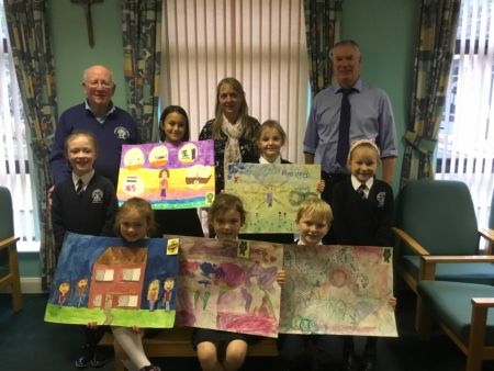 Congratulations to (front) Cheslie, Ashley, Pascal and (back) Aoife, Aliz, Aoife and Liepa who won prizes for their beautiful art work.  Also pictured are representatives from Omagh Credit Union with school Art Tutor, Mrs Sharyn Kelly, who runs the school's extra-curricular Arts & Crafts programme.